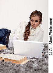 Young woman working on a university assignment