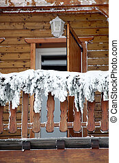 A chalet balcony on a freezing day