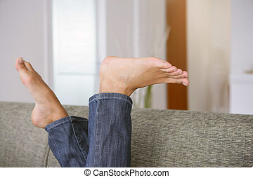 Bare feet on a sofa