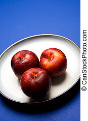 Nectarines - A shot of nectarines on a plate