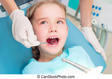 visit to dentist - portrait of a girl on reception at the...