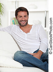 Young smiling on white sofa