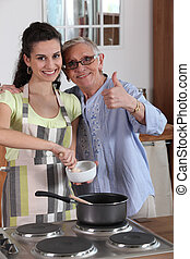 Woman cooking with her grandmother