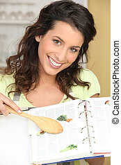 Woman with recipe book