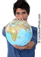 Man stood with globe