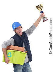 Builder with a trophy recycling material