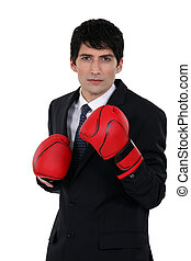 A businessman with boxing gloves.
