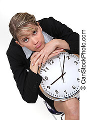 Businesswoman with a clock