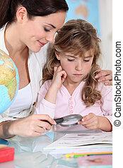 Mother teaching little girl