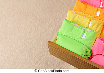 Cloth diapers - Drawer with multi-colored cloth diapers....