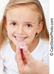 Girl receiving homeopathic medication - Happy young girl...