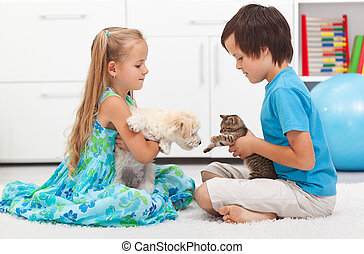 Kids with their pets - dog and cat - Kids playing with their...