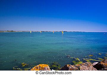 Sailing a blue sea - Colorful boats Sailing on a blue sea
