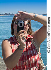 Woman taking Photographs - Woman on vacation taking...