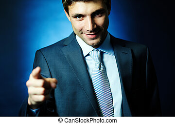 Attractive leader - Portrait of handsome male pointing at...