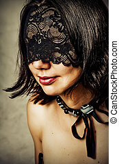 Sexy young woman with lace mask