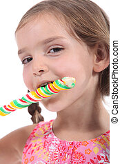 Cute kid with a swirly lolly