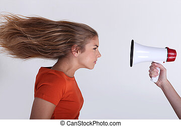 Girl with hair blown backwards by megaphone