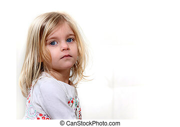 A cute little blond girl.