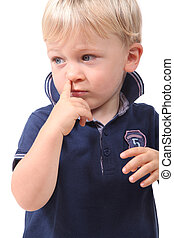 Boy picking his nose
