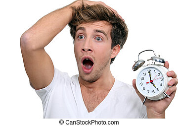 Man in a panic after sleeping in