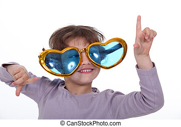 Young girl wearing funky glasses