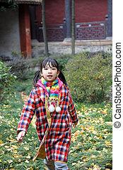 Asian kid walking