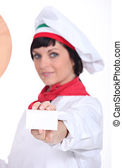 Pizza chef holding up a blank businesscard
