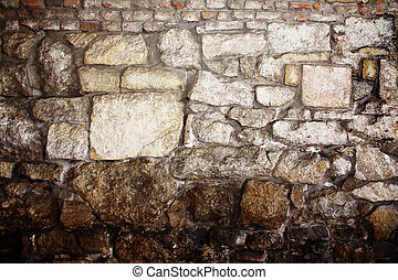 The background of the old masonry with traces of the former...