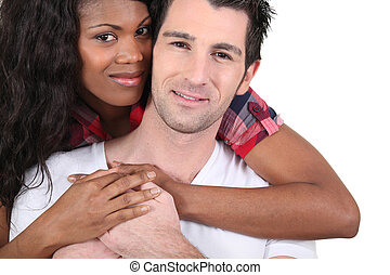 Afro woman and white man hugging