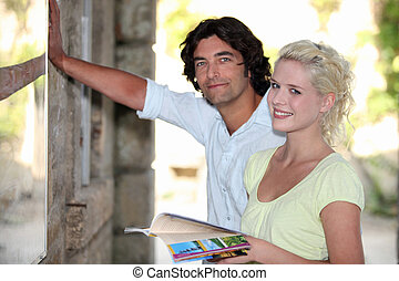 Couple looking at a tourist information board