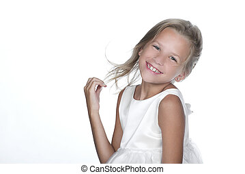 Adorable Child in White - Cute little girl smiling with hair...