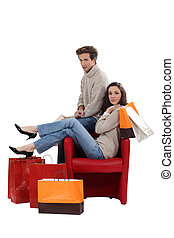 Portrait of a couple with their shopping bags