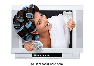Woman popping out the TV with hairroller on