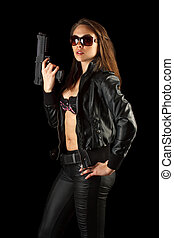 Woman posing with a gun - Young woman posing with a gun