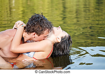Couple are kissing in the water