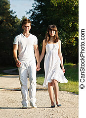 Couple walking in park