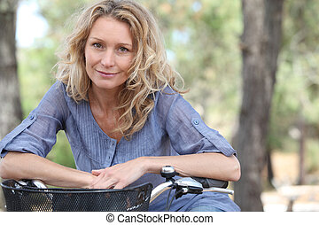 Blond woman on bike ride