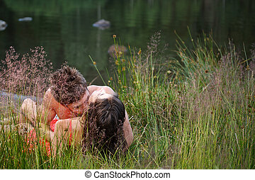 Couple lying on shore