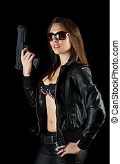 Woman posing with a gun