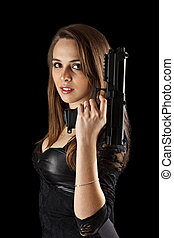 Young woman with gun in hand