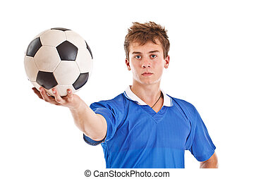 Soccer player - Young soccer player holding a soccer ball...