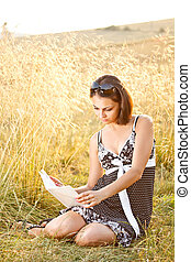 Young woman read book