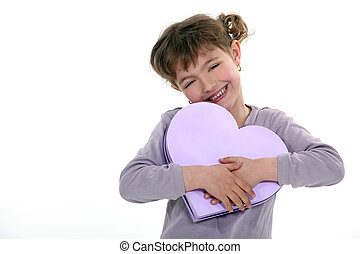 Girl holding a heart-shaped box
