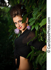 Fashion portrait of young sensual woman in forest