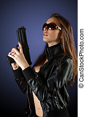 woman posing with gun