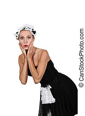 Woman in a saucy French maids outfit