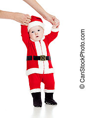 first steps of child dressed as Santa claus