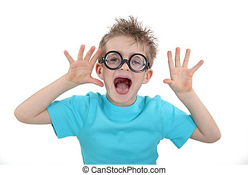 Child wearing wacky glasses and making a silly face