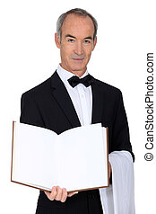 Grey haired waiter with menu